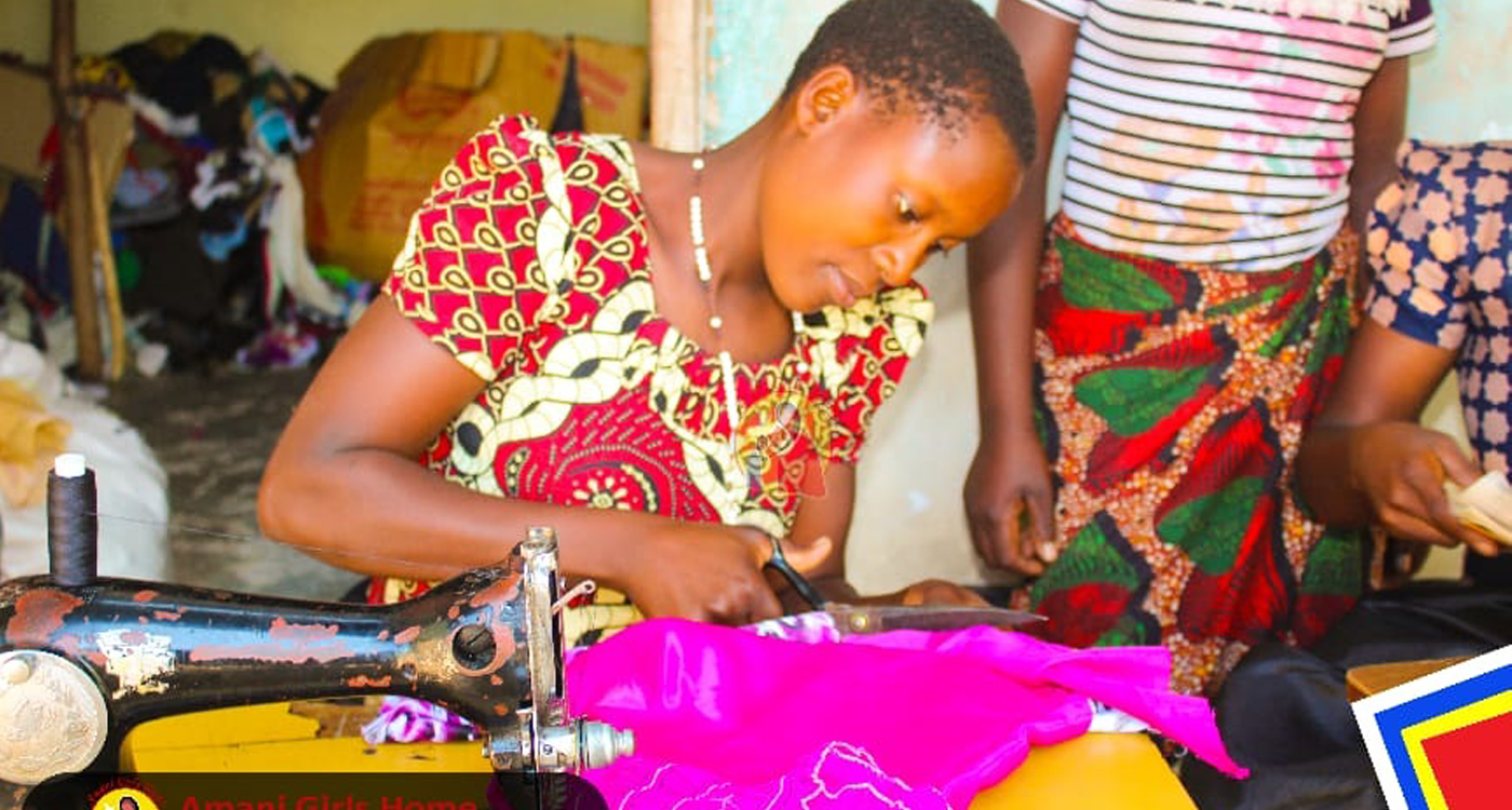 A Young woman Learning to sew through one of our projects.